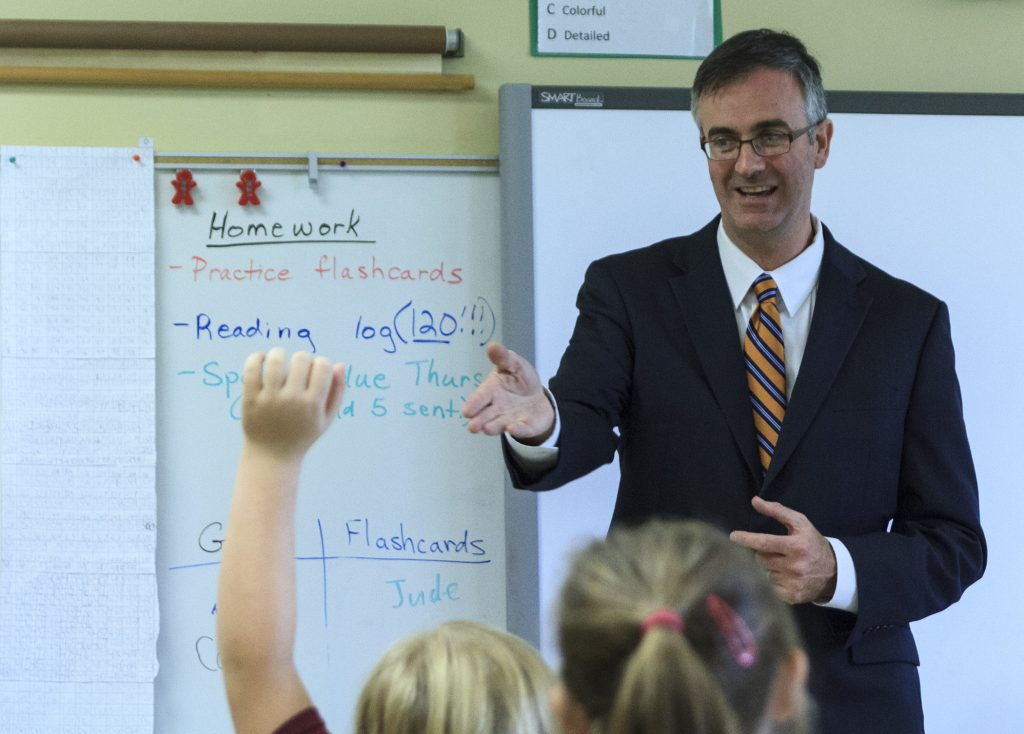 In every classroom he visited, Dr. Tom Burnford, NCEA president and CEO, engaged the students in lively discussion. CR photo: Skip Olson